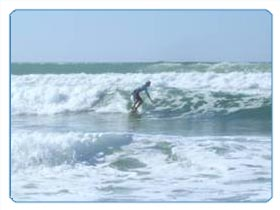 A young man tests the swell of the Atlantic waves